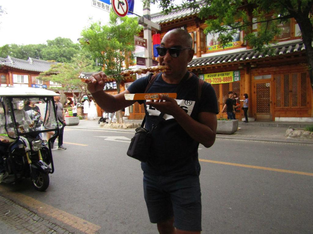 enjoying street food in Jeonju Hanok Village