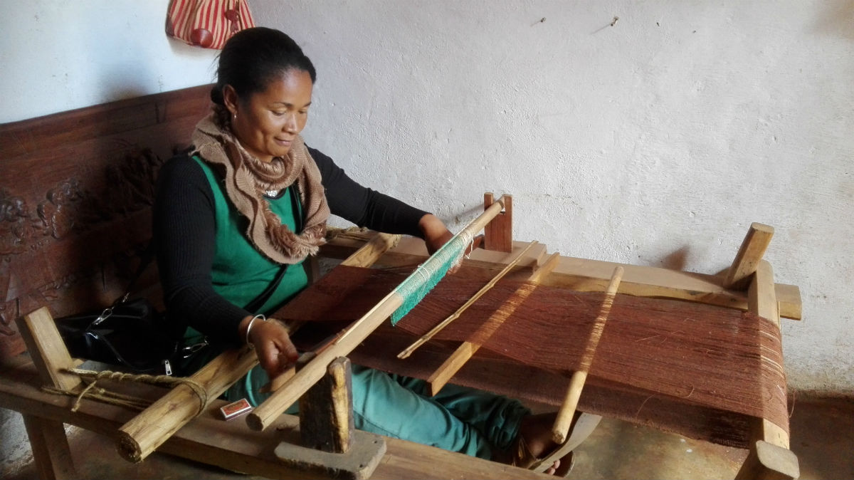Madagascar craft woman sewing