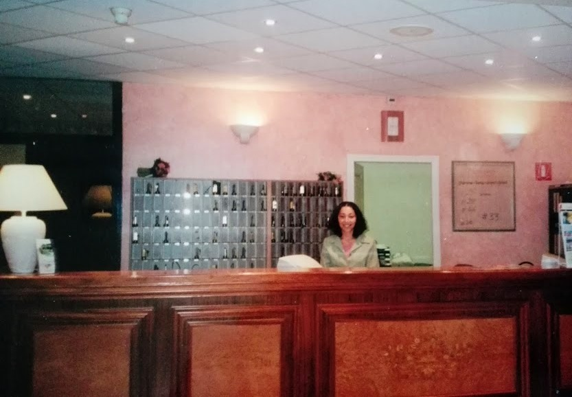 Me as a 22-year-old receptionist of a four-star hotel of the French Riviera!
