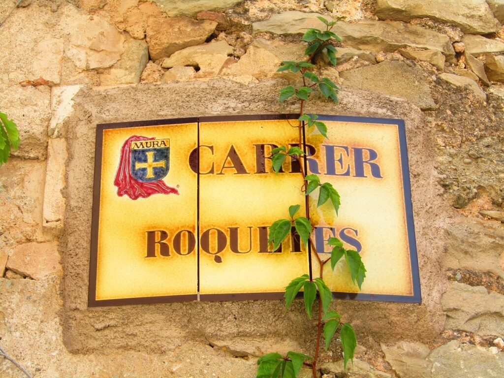 Mura street sign Carrer Roquetes