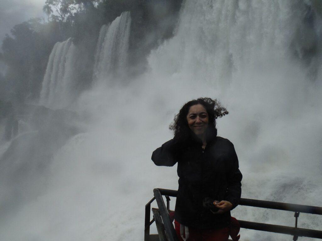 Ella at the Devil's Throat in Brazil getting wet despite the raincoat