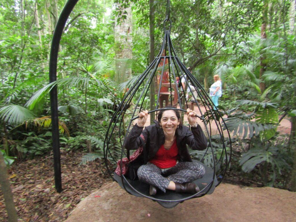 Ella in a bird's cage at the Birds Park