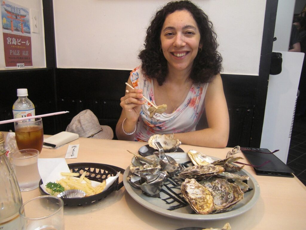 Ella having Grilled Oysters in Miyajima Japan