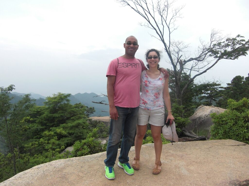 Reaching the top of Mount Misen